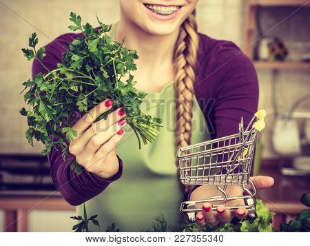 Buying Healthy Dieting Food Concept. Woman In Kitchen Having Many Green Vegetables Holding Small Sho