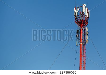 High Telephone Tower. Beautiful Sky With A Telecommunications Tower In The Foreground