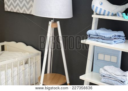 Children's room interior with crib and shelving unit, closeup