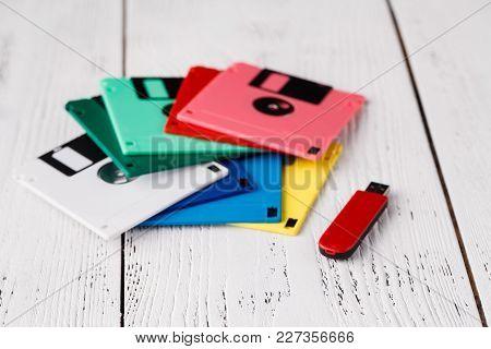 Pile Of Retro Floppy Disk Versus Usb Flash Driver