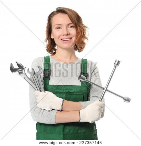 Female auto mechanic with tools on white background