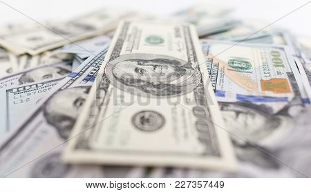 Heap Of Dollars As Background . Photo Of An Abstract Texture