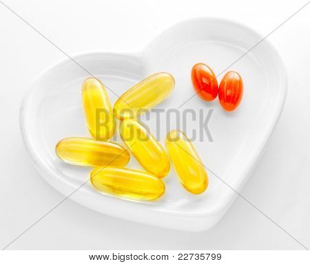 Omega-3 pills on a white hearth.