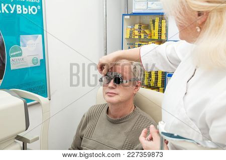 Saint Petersburg, Russia - February 13, 2018: A Mature Man Visits An Ophthalmologist. Diopter Select