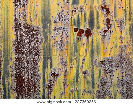 Abstract Rusted And Bubbling Metal Wall. Naturally Textured And Patterned, Heavily Rusted With Bubbl