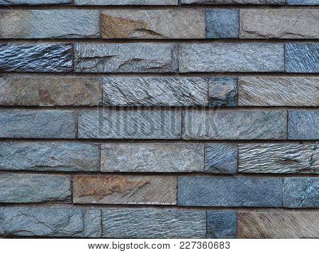 Slate Tile Brick Work Background Photograph. Rough Cut Textured Slate Stone Brick Shaped Tiles. Natu