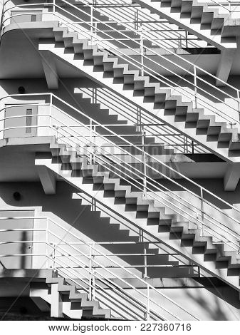 Abstract Of Floors Outdoor Stairways In Black And White. Monochrome Conceptual Image Of Exterior Sta