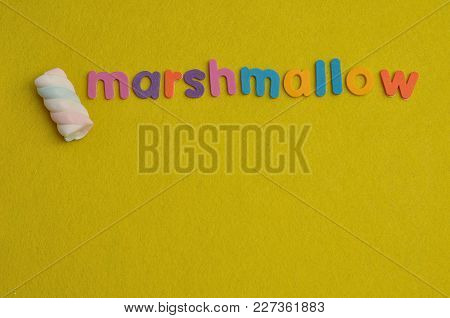 A Pastel Colored Marshmallow Displayed With The Word Marshmallow On A Yellow Background