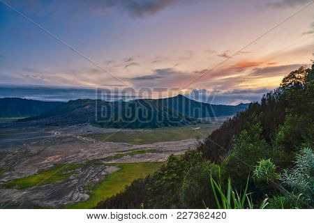 Sunset At Bromo Mount Bromo, Is An Active Volcano Located At Eat Java - Indonesia. Mount Bromo Is Th