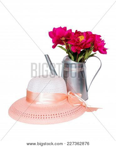 Bouquet Of Red Peonies In Watering Can And Hat Isolated On White Background
