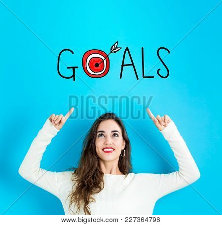 Goals With Young Woman Reaching And Looking Upwards