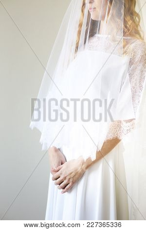 Young Pretty Blond Woman Wearing Wedding Dress Indoors. Close Up