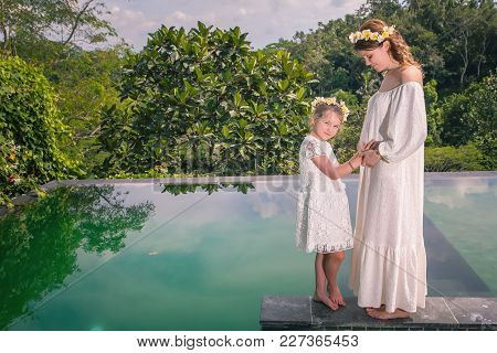 Happy Family, Pregnant Mom And Daughter Resting In Hotel In Ubud, Bali. Pregnant Bride