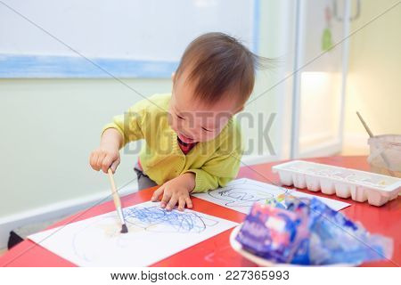 Cute Smiling Little Asian 18 Months / 1 Year Old Toddler Baby Boy Child Painting With Brush And Wate