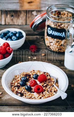 Healthy Breakfast Bowl. Homemade Granola With Natural Yoghurt, Blueberries And Raspberries