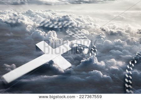 Religious Cross With Clouds In Background High Quality Stock Photo