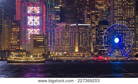 Luxury Large Touring Boat For Tourist Service In Victoria Harbor At Night View From Kowloon Side At