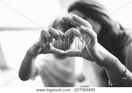 Mom With Son Hold Their Hands In The Shape Of Heart