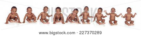 Ten funny african babies sitting on the floor isolated on white background