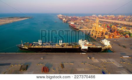 Logistic Container Ship At Shipping Yard Main Transportation Of Cargo Container Shipping.