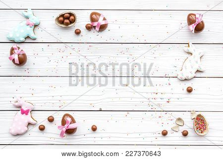 Celebrate Easter. Modern Signs Of Easter. Chocolate Easter Eggs And Easter Bunny Cookies. White Wood