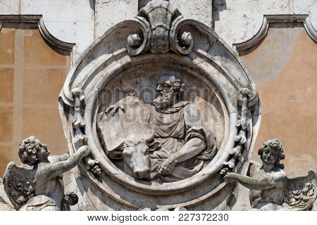 MANTUA, ITALY - JUNE 04: Saint Luke the Evangelist, statue on facade of the Mantua Cathedral dedicated to Saint Peter, Mantua, Italy on June 04, 2017.