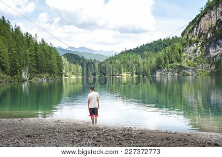 Carezza Lake In Trentino Alto Adige, Italy. Lake In The Alps With Wonderful Colors. The Dense Forest