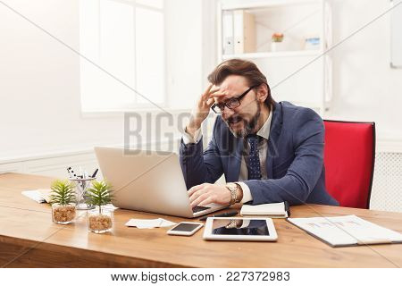 Overworking Employee In Office. Tired And Having Headache Businessman Working On New Project, Busine