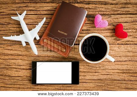 Passport And Black Coffee And A Wallet And A Plane Model And Red Heart And Smartphone With Copy Spac