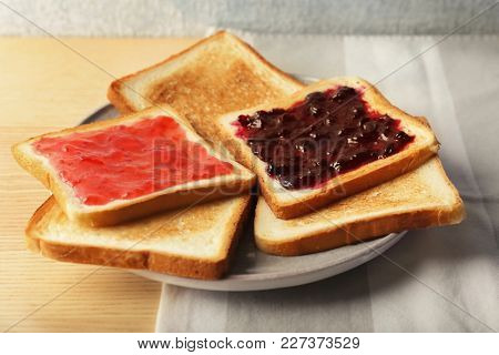 Delicious toasts with sweet jams on table