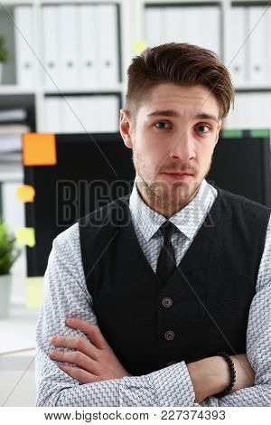 Handsome Man In Suit And Tie Stand In Office Looking In Camera Hands Crossed On Chest. White Collar
