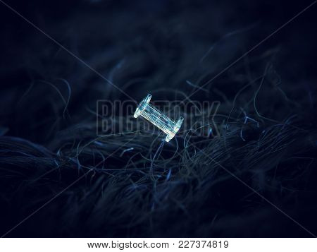 Unusual Snowflake Glowing On Dark Blue Textured Background. Macro Photo Of  Real Snow Crystals: Capp