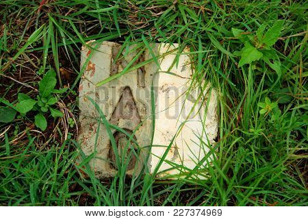 Stone Plaques From The Mines Advisory Group Mark The Location Of Unexploded Bombs Made Safe In The P