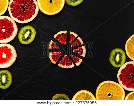 Citrus And Kiwi Frame Template On Black Texturised Background. Photo With Orange, Grapefruit And Kiw