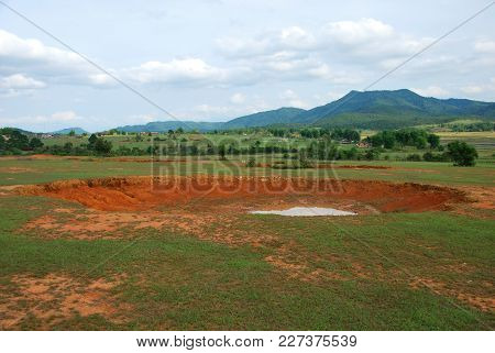 Bomb Craters In The World's Most Heavily Bombed Place Near The Plain Of Jars Archaeological Site In