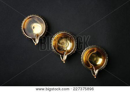 Diwali diyas or clay lamps on dark background