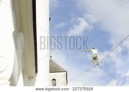 Tightrope Walker, Man Hanging On A Rope Walks In The Sky