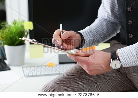 Male Arm In Suit Hold Silver Pen And Pad Making Note In Office Closeup. Deal Consult Delivery Signat