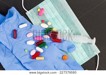 Latex Gloves Pills And Syringe With Vaccine Serum.