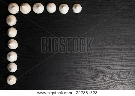 A Lot Of Delicious Merengues On The Wood Black Background