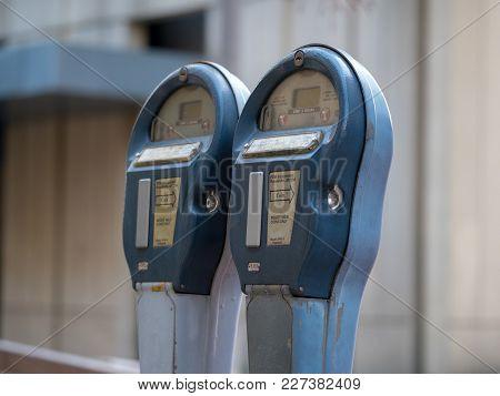 Dual Parking Meter On Street, Blurred Background
