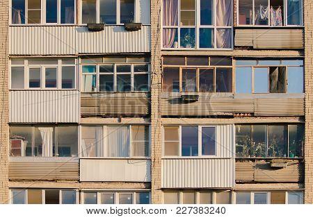 Brick High-rise Apartment Building Exterior With Loggias In Russia