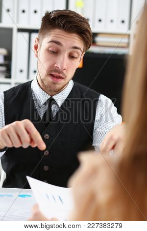 Handsome Man In Suit Offer Contract Form On Clipboard Pad And Silver Pen Portrait. Strike A Bargain