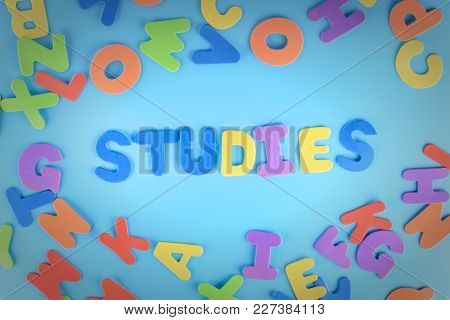 Beautifully Laid Out Inscription Studies Of Multi-colored Letters. Blue Background With Vignette.