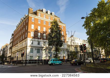 London, England - October 25 2017: Sunny Day On The Streets Of London Near Hyde Park. Colorful Cars