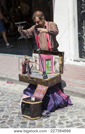 Buenos, Aires, Argentina - January 21, 2018: Unidentified Man Doing Puppet Show On San Telmo Flea Ma
