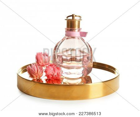 Tray with bottle of perfume on white background