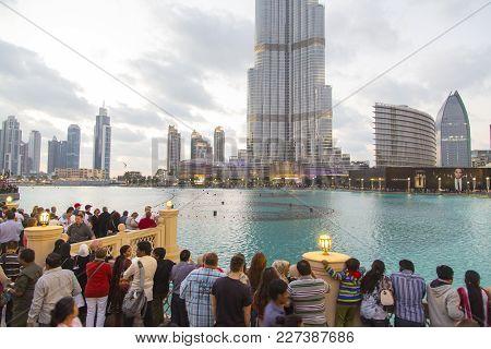 Dubai, Uae - January 16, 2014: Unindentified People By Burj Khalifa In Dubai. This Skyscraper Is The