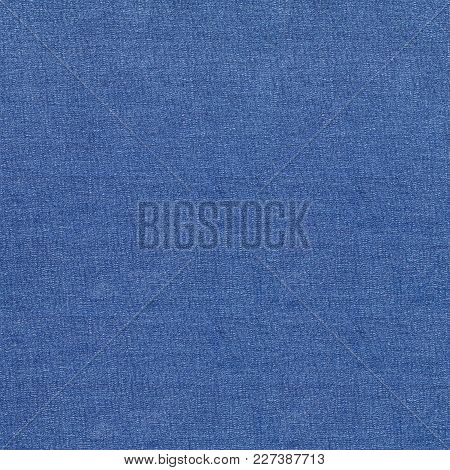 Tileable Blue Jeans Background And Texture, Denim Plain Surface Background.