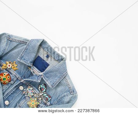 Jeans Denim Woman Jacket With Vintage Brooches On White Background. Fashion Outfit.